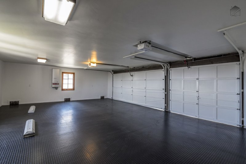 The large garage has space for 3 vehicles, with additional space available in the driveway.