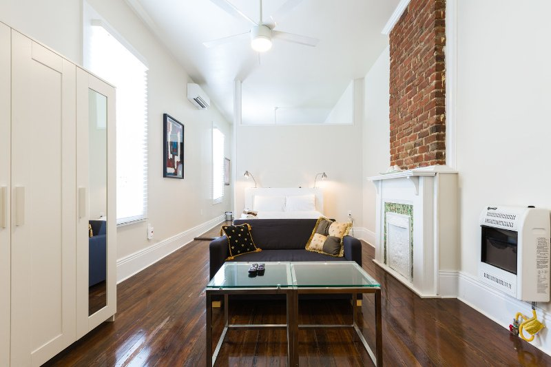 The space, high ceilings, original wood floor, mantels, lots of natural light