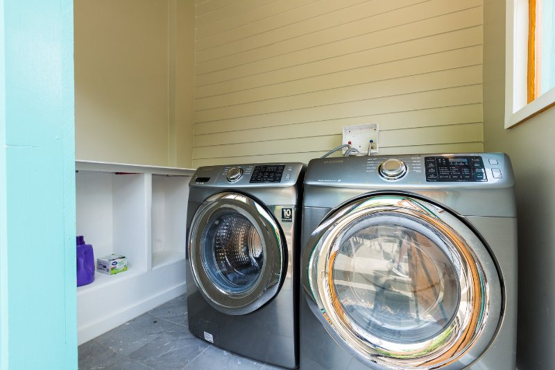 Shared laundry room with full washer and dryer