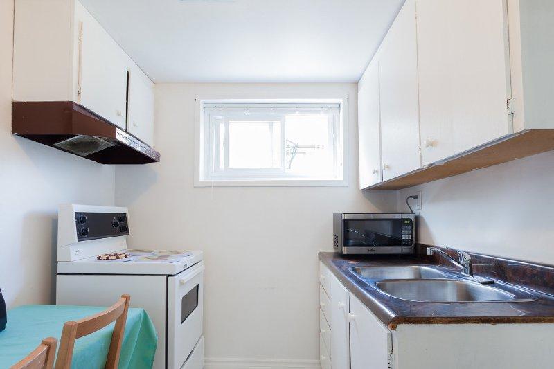 Menor de muebles de cocina con sala de estar