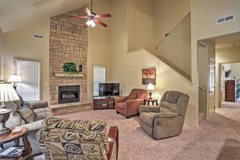 The living room is very relaxing, complete with a fireplace and flat screen TV.