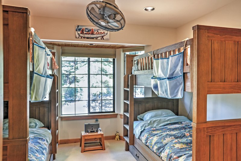 There's enough room for your entire group with sets of 2 twin-sized bunk beds and a single trundle.