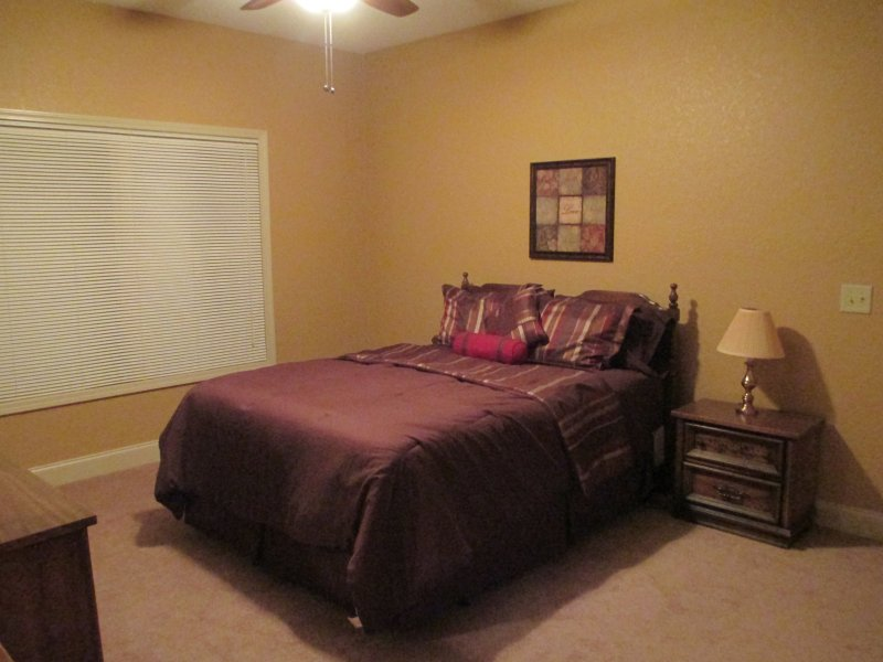 Master Bedroom with queen bed, dressers, flat-screen TV, and walk-in closet!