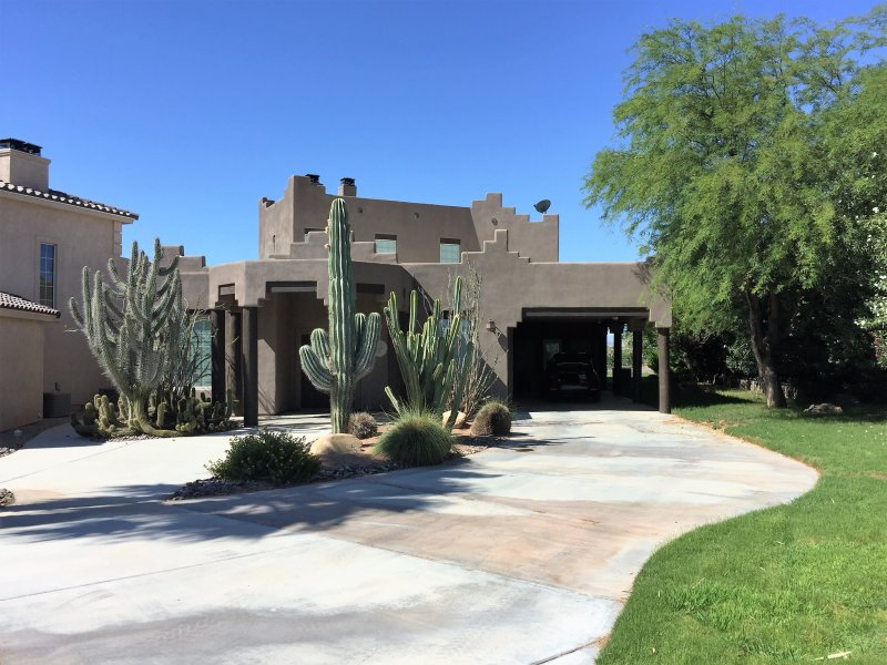 The front of the house with the cactus garden
