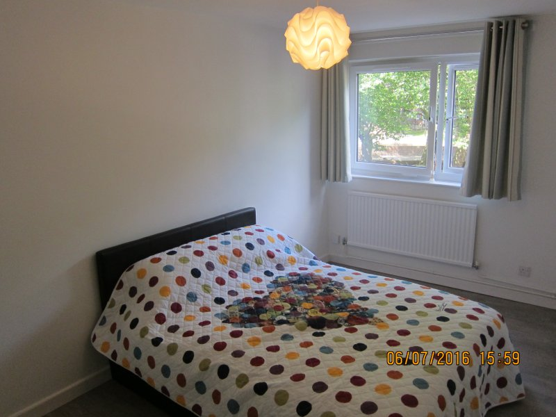 Comfy Double Bedroom. Window looks onto leafy play areas and Regents Canal to the left.