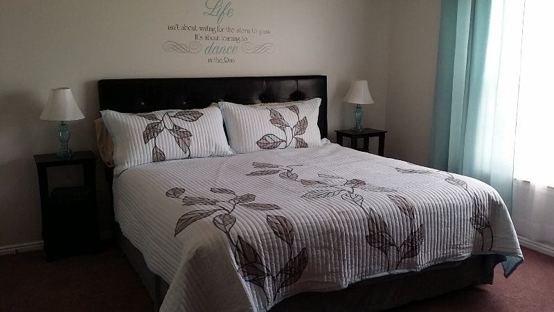 Serenity Room - large room with king size bed and shared bath.