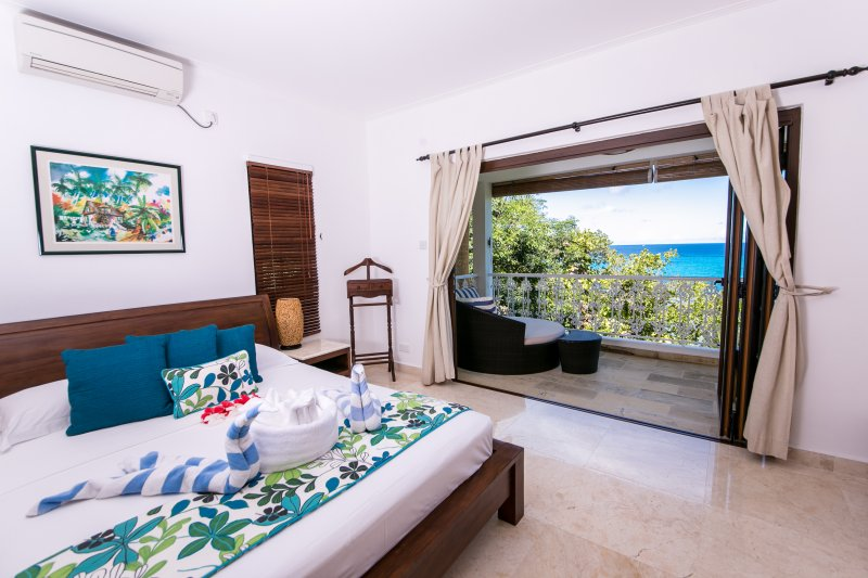 Master bedroom and verandah looking out to sea