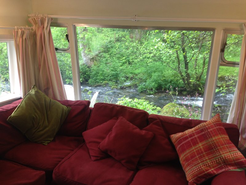 View from inside cabin, overlooking the river