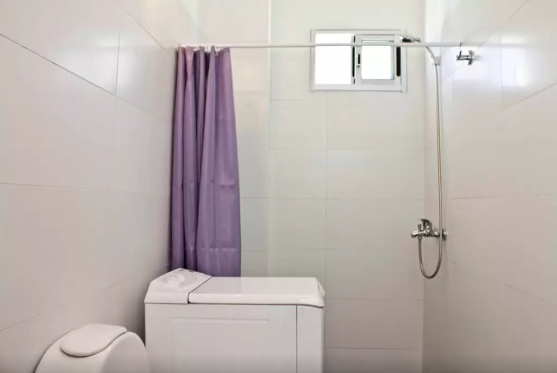 Bathroom with shower and washing machine ensuite with second bedroom