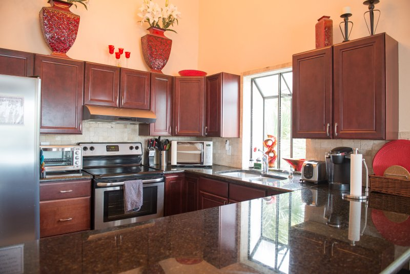 Large, open kitchen with stainless steel appliances and granite countertops