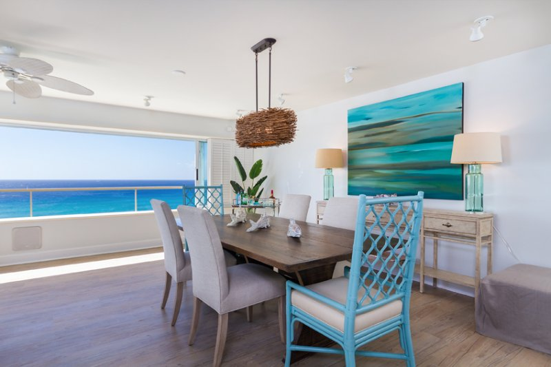 Original art work and designer furnishings throughout with an upscale beach theme.