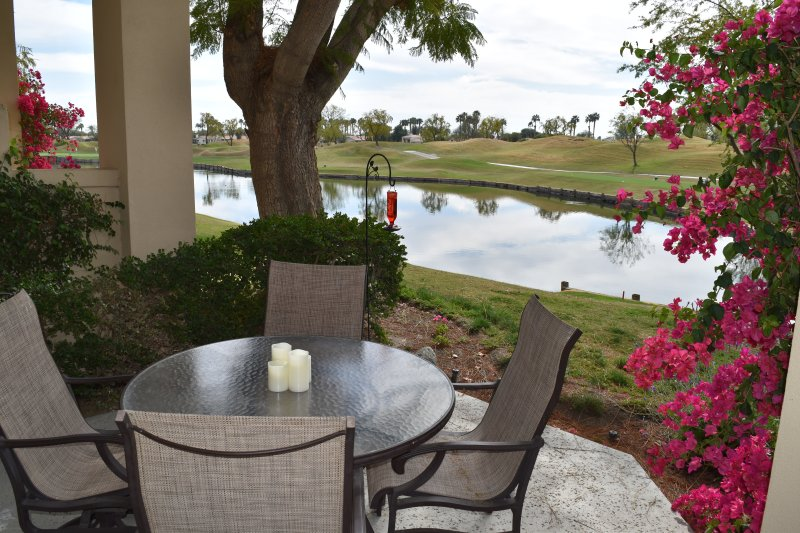 Gorgeous patio view of the 13th hole and lake at PGA West Stadium golf course.