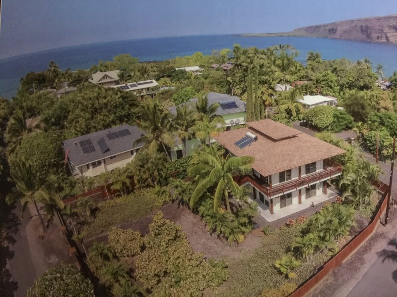 Birds' eye view of home with large private fenced yard and step from the best beach.