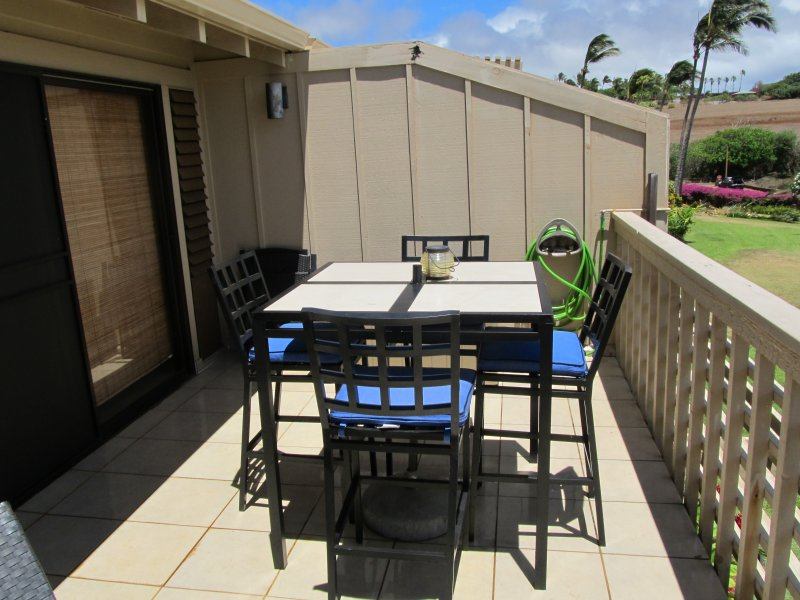 Bar height outdoor set for unobstructed view of Papohaku Beach