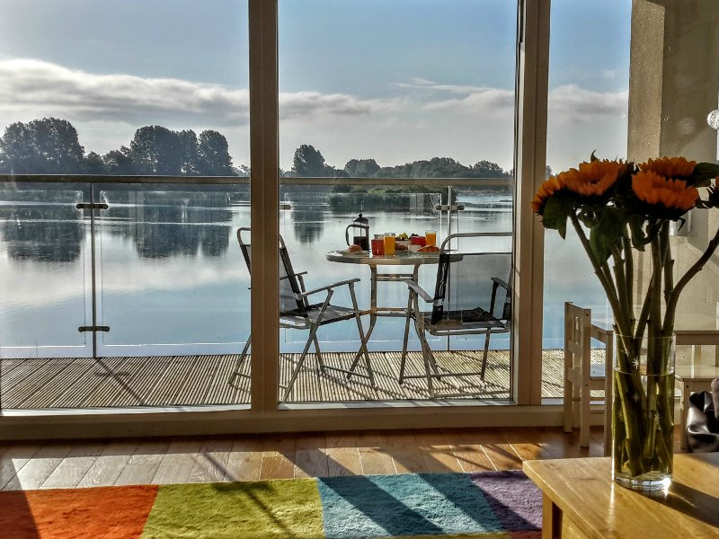 Relaxed family living with wonderful uninterrupted lake views from the balcony.