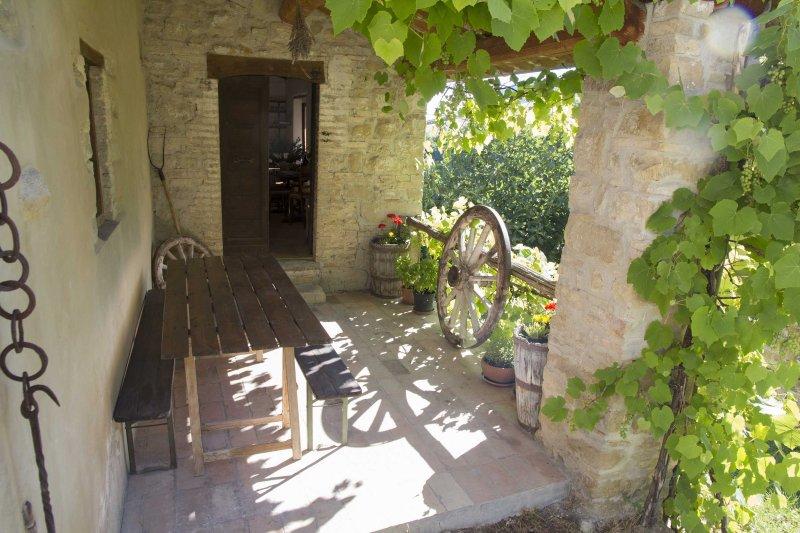 Veranda e porta d'ingresso alla cucina