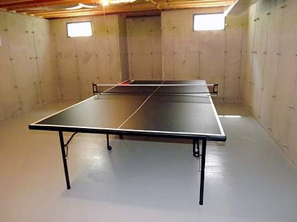 Ping Pong Table in Unfinished Basement