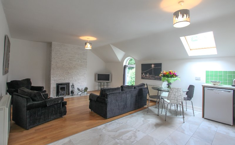 Spacious Living area to include turf burning stove and feature granite wall