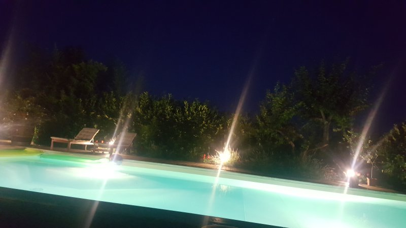POOL ILLUMINATED AT NIGHT