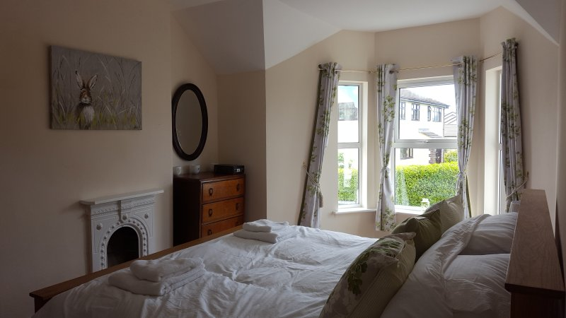 Master bedroom with Super Kingsize bed and period furniture