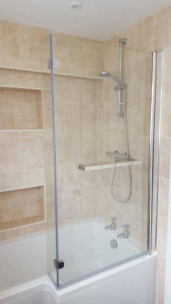 Beautiful fully tiled new bathroom