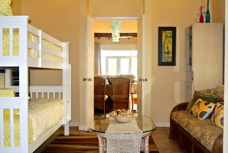 The bonus room off the Master has bunk beds w comply mattresses & a queen sleeper. Can be closed off