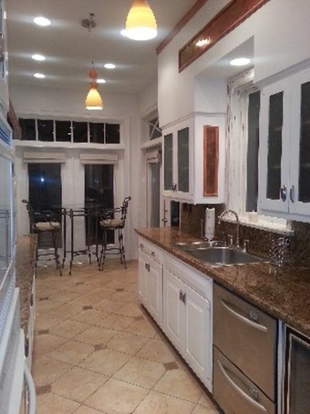 High end modern kitchen with granite counter and center island, all stainless steel appliances