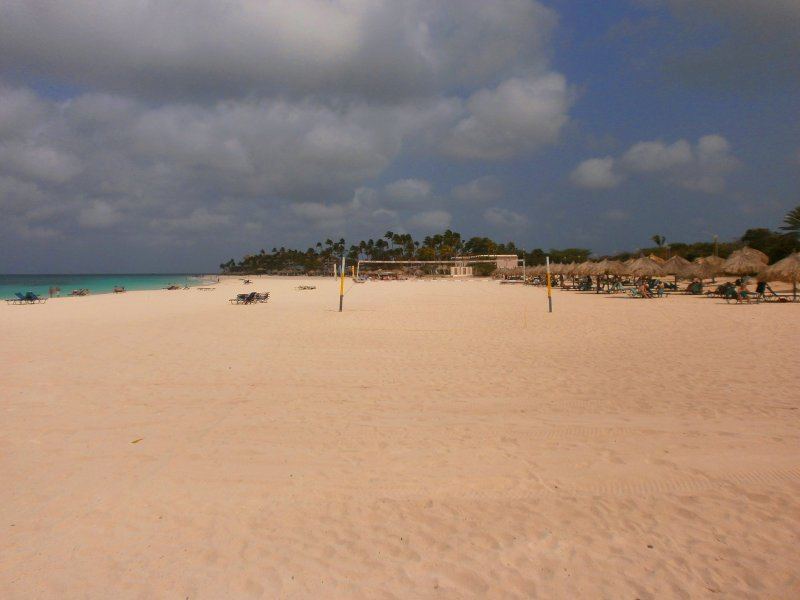 Spend lazy days exploring miles of white sand beaches of Druif Beach.