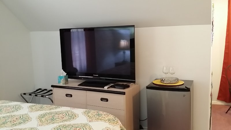 Large screen tv and refrigerator