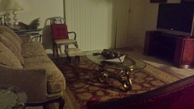 Living room. Has sliding door to the porch.