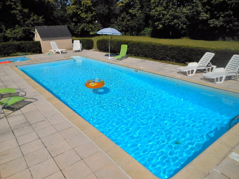 !2 metres by 5 metres heated swimming pool (2 metres at the deep end) and childs paddling pool