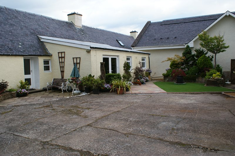 Kewnston, the entire large former Farmhouse set in a private courtyard., holiday rental in Kirkmichael