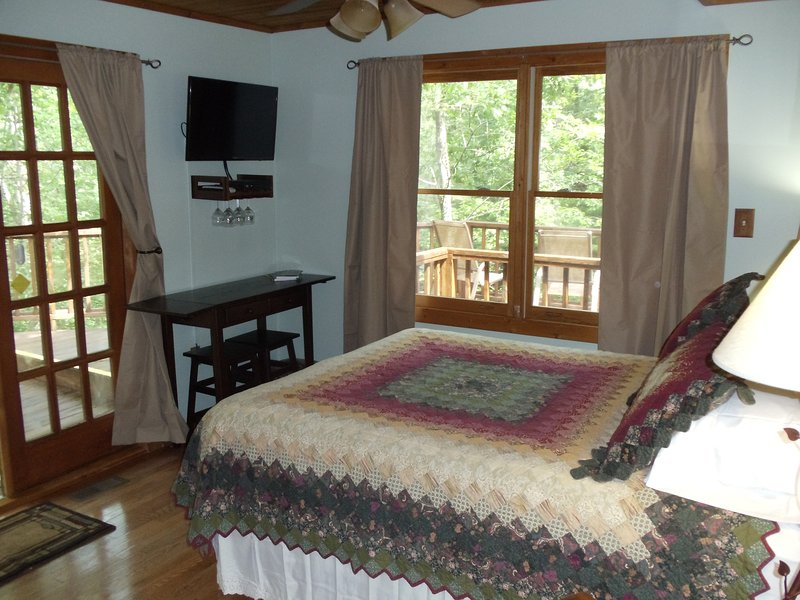 queen bed with a tree top view