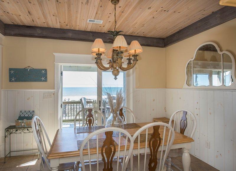 Dining room has beautiful beach views.