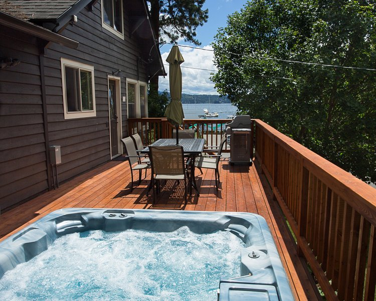 Hot tub, family seating and barbecue overlooking the lake all on a brand new deck!