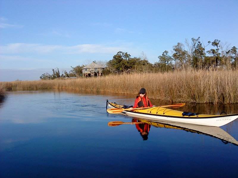 Kayaking with house in background