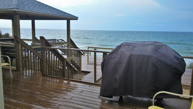 Private deck off living room connected by 3 panel glass door. 5 burner propane grill, gazebo.
