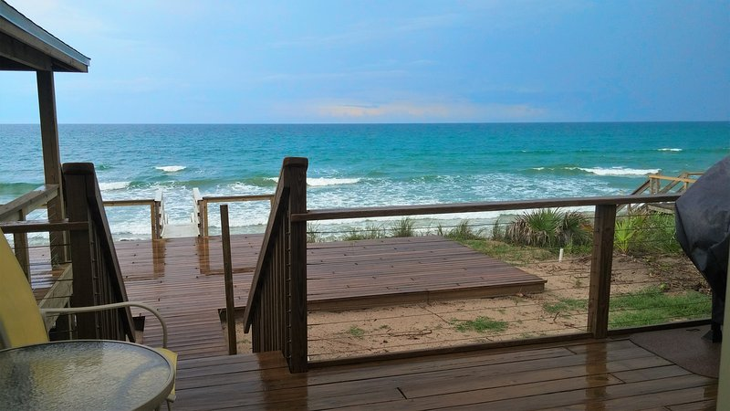 Your ocean view from deck adjoining the living room. Gazebo on left and grill on right