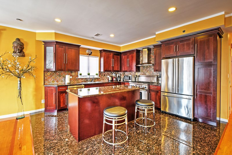 This gorgeous kitchen comes fully equipped with all the necessary cooking appliances and utensils