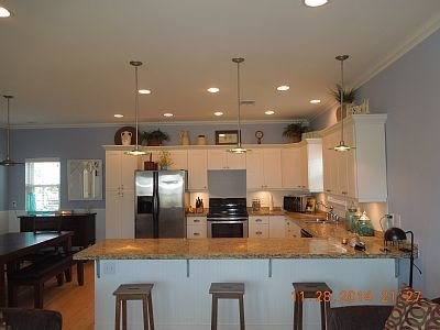 Beautiful wood floors on first floor. Dining and breakfast bar seat total of 11.