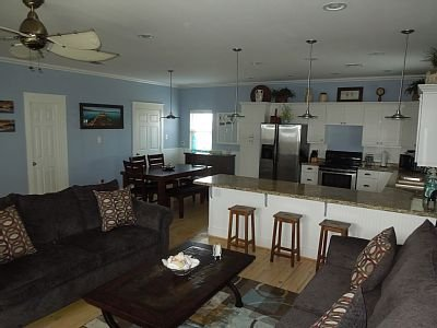 Beautiful wooden floors throughout this first level are warm and inviting.