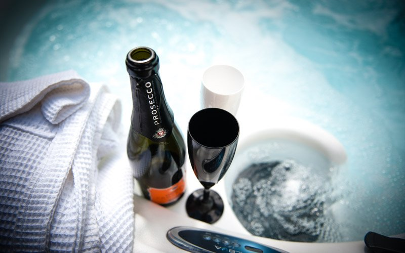 Hot Tub with polycarbonate glasses to use, robes and slippers & towels all provided