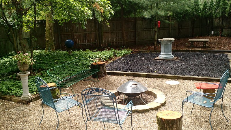 Front courtyard with fire pit, gas and charcoal grills.  Perfect for just hanging out.