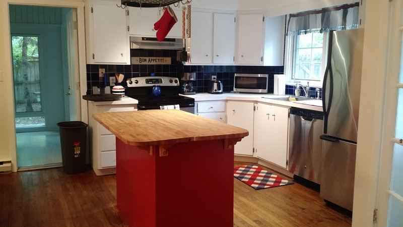 Kitchen with stainless steel appliances, microwave, dishwasher and all the amenities you may need.