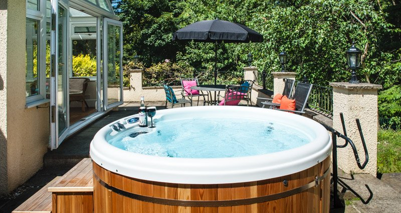Acorns Ground floor Garden Apartment for couples with own Hot Tub. Bottle for advert & not supplied.