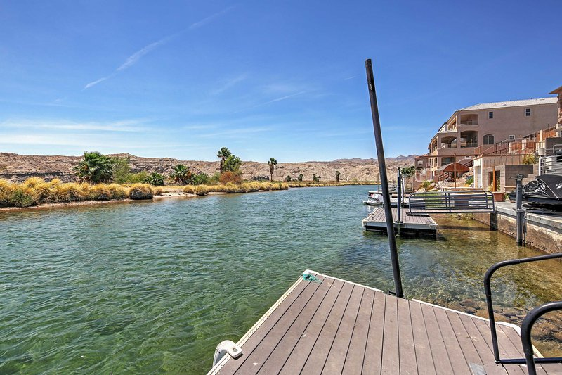 Use this vacation rental's private dock to launch your river adventure.