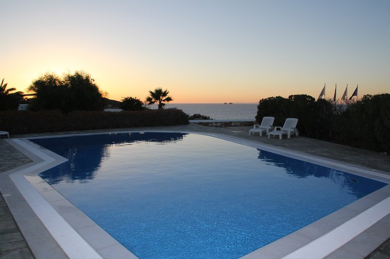 The pool at sunset looking towards the sea