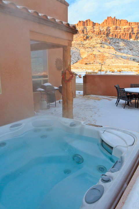 From the private hot tub: Rim views one direction, Snow-capped La Sal Mountains the other