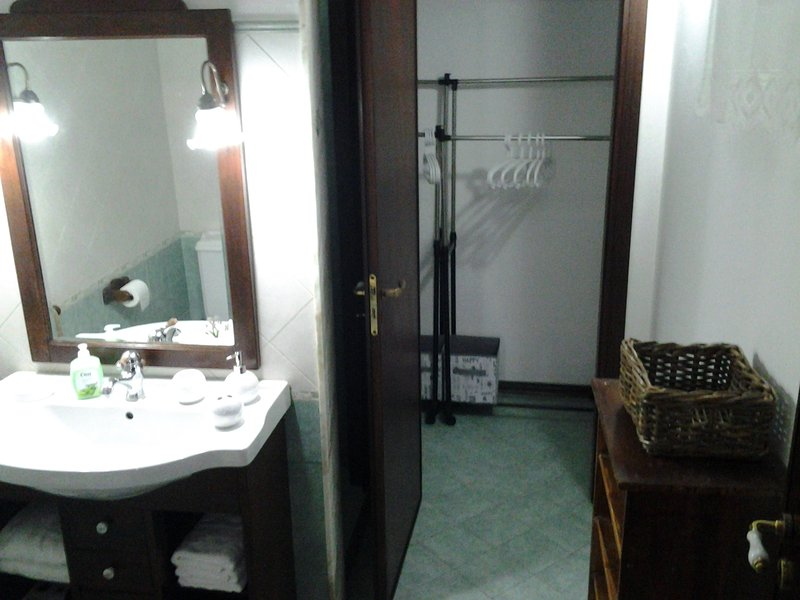 The bathroom with walk-in closet