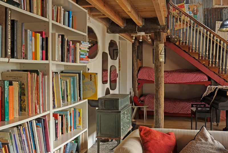 Bunk beds under the stairs